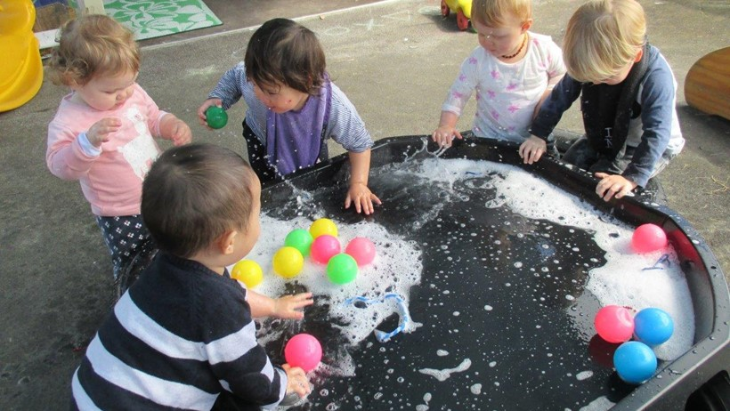 water play children at daycare