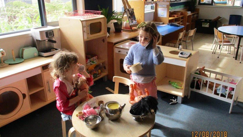 children role playing at daycare Tuakana Big Buddies Room