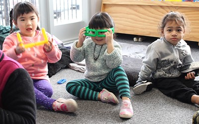 children on mat with fun glasses at daycare