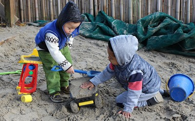 boys in sandpit at childcare